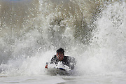 MANHATTAN BEACH, CALIFORNIA, USA - SEPTEMBER 28, 2012. Surfers enjoy large waves on September 28, 2012.  Large waves are caused by the 13th named Pacific Tropical Storm - Miriam to the south.