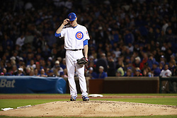 October 17, 2017 - Chicago, IL, USA - Chicago Cubs starting pitcher Kyle Hendricks regroups after the Los Angeles Dodgers' Chris Taylor hits an RBI triple in the fifth inning during Game 3 of the National League Championship Series at Wrigley Field in Chicago on Tuesday, Oct. 17, 2017. (Credit Image: © Nuccio Dinuzzo/TNS via ZUMA Wire)