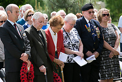 © Licensed to London News Pictures. 06/06/2014. National Memorial Arboretum, Alrews, Staffordshire, UK. The D Day service at the Normandy Memorial, National Memorial Arbouretum. Pictured, dignitries paying their respects during the service. Photo credit : Dave Warren/LNP