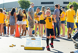 Sep 3, 2016; Morgantown, WV, USA; A young West Virginia Mountaineer fan plays cornhole before kickoff against the Missouri Tigers at Milan Puskar Stadium. Mandatory Credit: Ben Queen-USA TODAY Sports