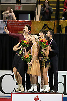 KELOWNA, BC - OCTOBER 26: Ice dance silver medalists, Madison Hubbell and Zachary Donohue of the United States, and gold medalists Piper Gilles and Paul Poirier of Canada and bronze medalists Lilah Fear and Lewis Gibson of Great Britain take a selfie on the podium during medal ceremonies of Skate Canada International held at Prospera Place on October 26, 2019 in Kelowna, Canada. (Photo by Marissa Baecker/Shoot the Breeze)