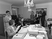 Presentation Of Donnelly Visas.  (R71)..1988..19.01.1988..01.19.1988..19th January 1988..As part of his interest in Ireland Congressman Brian Donnelly promoted a visa scheme to easily allow Irish people entry into America. Known now as the Donnelly Visas,Congressman Donnelly came to The American Embassy in Dublin to present the new visas to those where lucky enough in the first draw to obtain the visas...Image shows the administration office in the Embassy where Ambassador Heckler and Congressman Donnelly oversee the preparation of the visas.