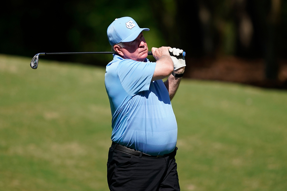 North Carolina head football coach Mack Brown tees off  during the Chick-fil-A Peach Bowl Challenge at the Ritz Carlton Reynolds, Lake Oconee, on Tuesday, April 30, 2019, in Greensboro, GA. (Paul Abell via Abell Images for Chick-fil-A Peach Bowl Challenge)