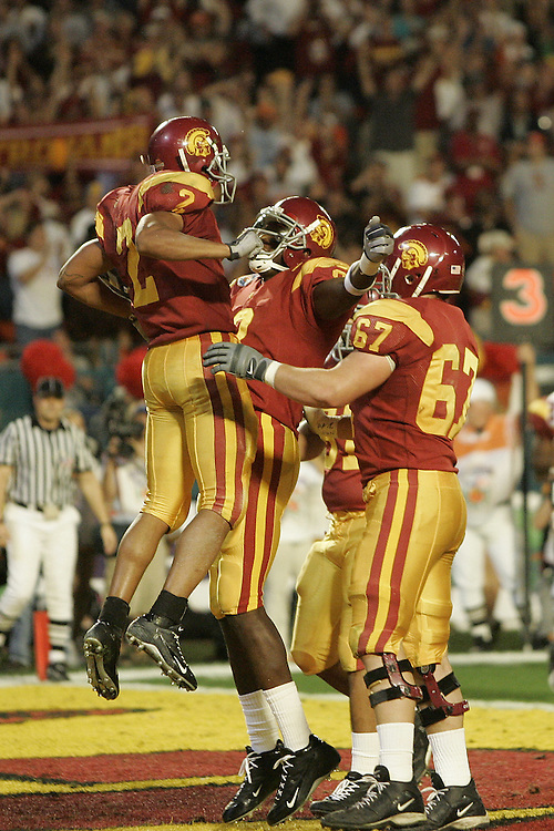 University of Southern California wide receiver Steve Smith (2) celebrates with wide receiver Dwayne Jarrett (8) and center Ryan Kalil (67) after catching a pass for a touchdown during USC's 55-19 victory over Oklahoma on January 4, 2005 in the FedEx Orange Bowl at Pro Player Stadium in Miami, Florida.