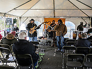 Inside the tent, the Crowns of Life Gospel band plays.