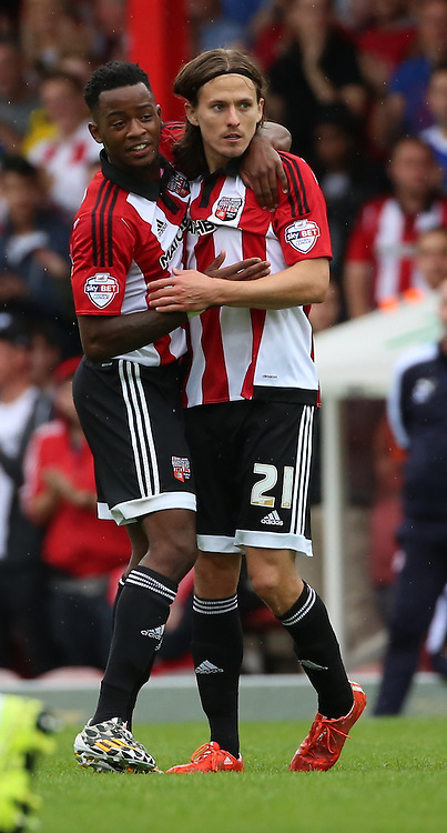 Lasse Vibe (Brentford striker) celebrating with Josh Clarke (Brentford midfielder) after scoring during the Sky Bet Championship match between Brentford and Reading at Griffin Park, London, England on 29 August 2015. Photo by Matthew Redman.