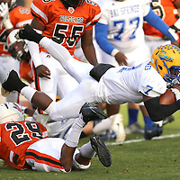 Adam Robison   BUY AT PHOTOS.DJOURNAL.COM<br /> Bay Springs running back Jaylin Jones dives for yards over Calhoun City's Jessie Nabors in the second quarter.