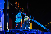 """ROME, ITALY - 27 JUNE 2017: (L-R) Opera singer Reut Ventorero (in the role of Zerlina) and Federico Cavarzan (in the role of Masetto) are seen here on stage performing in the """"Don Giovanni OperaCamion"""", an open-air opera performed on a truck in San Basilio, a suburb in Rome, Italy, on June 27th 2017.<br /> <br /> Director Fabio Cherstich's idae of an """"opera truck"""" was conceived as a way of bringing the musical theatre to a new, mixed, non elitist public, and have it perceived as a moment of cultural sharing, intelligent entertainment and no longer as an inaccessible and costly event. The truck becomes a stage that goes from square to square with its orchestra and its company of singers in Rome. <br /> <br /> """"Don Giovanni Opera Camion"""", after """"Don Giovanni"""" by Wolfgang Amadeus Mozart is a new production by the Teatro dell'Opera di Roma, conceived and directed by Fabio Cherstich. Set, videos and costumes by Gianluigi Toccafondo. The Youth Orchestra of the Teatro dell'Opera di Roma is conducted by Carlo Donadio."""