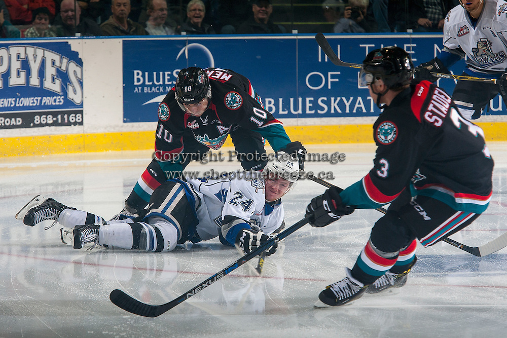 KELOWNA, CANADA - OCTOBER 26: Nick Merkley #10 of the Kelowna Rockets checks Regan Nagy #24 of the Victoria Royals to the ice during first period on October 26, 2016 at Prospera Place in Kelowna, British Columbia, Canada.  (Photo by Marissa Baecker/Shoot the Breeze)  *** Local Caption ***