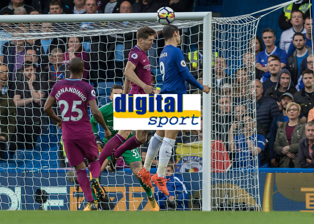 Football - 2017 / 2018 Premier League - Chelsea vs Manchester City<br /> <br /> Alvaro Morata (Chelsea FC)  beats John Stones (Manchester City) to the header  at Stamford Bridge <br /> <br /> COLORSPORT/DANIEL BEARHAM