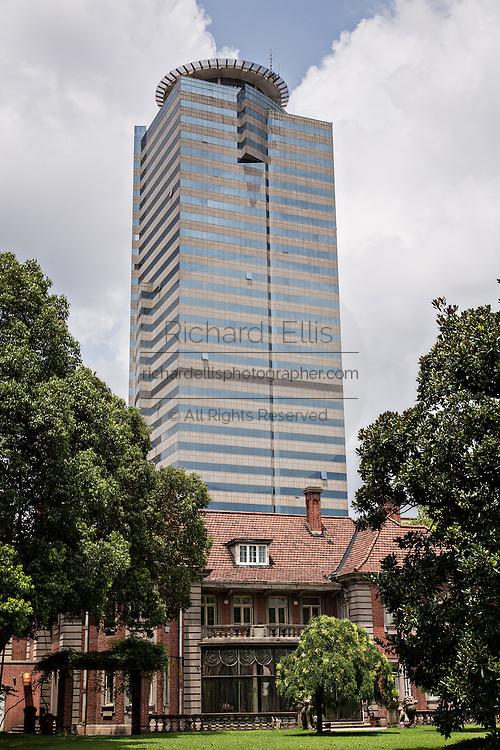 Historic Ruijin Hotel contrasts against a modern skyscraper in Shanghai, China