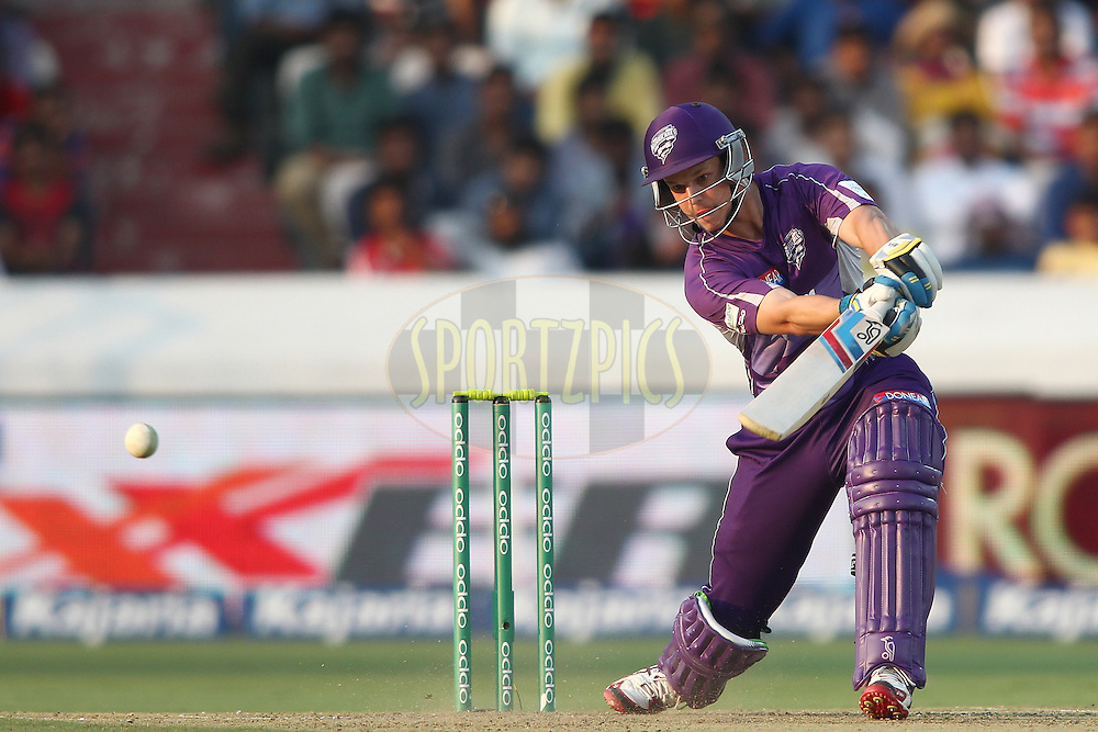Evan Gulbis of the Hobart Hurricanes drives a delivery through the covers during the first semi final match of the Oppo Champions League Twenty20 between the Kolkata Knight Riders and the Hobart Hurricanes held at the Rajiv Gandhi Cricket Stadium, Hyderabad, India on the 2nd October 2014<br /> <br /> Photo by:  Shaun Roy / Sportzpics/ CLT20<br /> <br /> <br /> Image use is subject to the terms and conditions as laid out by the BCCI/ CLT20.  The terms and conditions can be downloaded here:<br /> <br /> http://sportzpics.photoshelter.com/gallery/CLT20-Image-Terms-and-Conditions-2014/G0000IfNJn535VPU/C0000QhhKadWcjYs