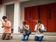 11 FEBRUARY 2015 - BANGKOK, THAILAND: People pray at Wat Kalayanamitr in the Thonburi section of Bangkok. The Buddhist temple is next to the Catholic community of Santa Cruz. The temple was built in 1825, about 50 years after Santa Cruz Church was built.         PHOTO BY JACK KURTZ