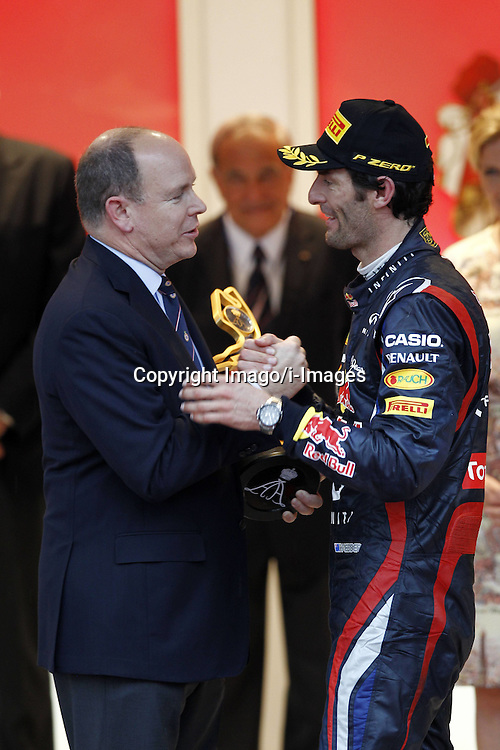 Prince Albert II presents Mark Webber of Australia and Red Bull Racing the trophy as he celebrates winning the Monaco Formula One Grand Prix at the Circuit de Monaco, Sunday May 27, 2012 in Monte Carlo, Monaco. Photo By Imago/i-Images