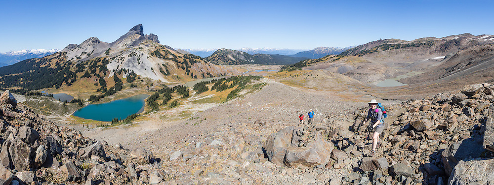 The volcanic pinnacle of Black Tusk (2319 m or 7608 ft) rises above Mimulus Lake (on far left), turquoise Black Tusk Lake, and Helm Lake, seen from Panorama Ridge Trail. The Black Tusk is a remnant of an extinct andesitic stratovolcano which formed 1.3-1.1 million years ago: after long glacial erosion, renewed volcanism 170,000 years ago made the lava flow and dome forming the tooth-shaped summit. The top of Panorama Ridge is 17 miles round trip with 5100 feet gain from Rubble Creek parking lot (or 6 miles/10k RT with 2066 ft/630m gain from either Taylor Meadows or Garibaldi Lake Backcountry Campground). A hiking loop to Garibaldi Lake via Taylor Meadows Campground is 11 miles (18k) round trip, with 3010 ft (850m) gain. Garibaldi Provincial Park is east of the Sea to Sky Highway (Route 99) between Squamish and Whistler in the Coast Range, British Columbia, Canada. This panorama was stitched from 12 overlapping images.