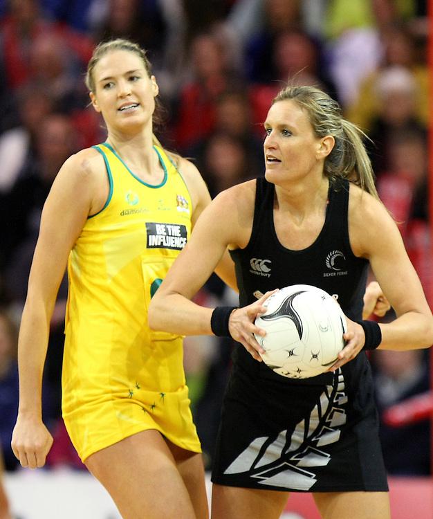 New Zealand's Leana de Bruin, right, looks to pass the ball against Australia in the New World Netball Series match, SIT Zero Fees Velodrome, Invercargill, New Zealand, Sunday, September 15, 2013. Credit:SNPA / Dianne Manson.