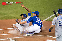 Oct 20, 2015; Toronto, Ontario, CAN; Toronto Blue Jays starting pitcher R.A. Dickey (43) tags out Kansas City center fielder Royals Lorenzo Cain (6) in game four of the ALDS at Rogers Centre. Mandatory Credit: Peter Llewellyn-USA TODAY Sports
