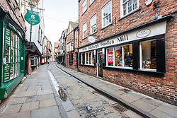 © Licensed to London News Pictures. 19/03/2020. York UK. One of York's best known & normally busiest street's The Shambles is almost empty this morning after Government advice to work from home & avoid pubs & restaurants due to the Covid19 virus. The street was mentioned in the Domesday Book of 1086 & is thought to be the inspiration for Diagon Alley in the Harry Potter book's & is a popular tourist destination. Photo credit: Andrew McCaren/LNP