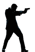 one caucasian spy criminal policeman detective man aiming shooting gun  full length silhouette in studio isolated white background