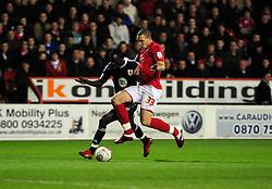 Bristol City's Albert Adomah Battles for the ball with Nottingham Forest's Joel Lynch - Photo mandatory by-line: Matt Bunn/JMP - 25/01/2011 - SPORT - FOOTBALL - npower championship-Nottingham Forest v Bristol city-City Ground-Nottingham