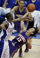 The Suns' Steve Nash shoots and scores over the Clippers' Quinton Ross while being knocked down during the third quarter of Game 3 of the Western Conference Semi-finals Friday, May 12, 2006.