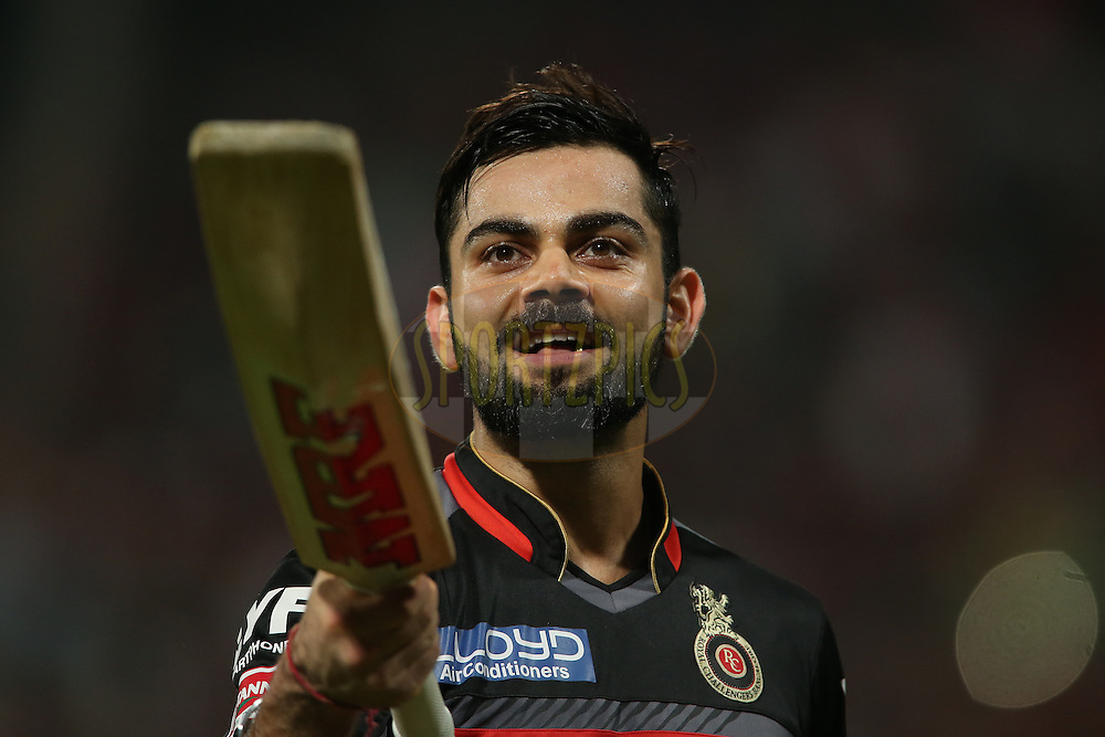 Royal Challengers Bangalore captain Virat Kohli raise his bat to the fans after losing his wicket for 113 during match 50 of the Vivo IPL (Indian Premier League) 2016 between the Royal Challengers Bangalore and the Kings XI Punjab held at The M. Chinnaswamy Stadium in Bangalore, India,  on the 18th May 2016<br /> <br /> Photo by Shaun Roy / IPL/ SPORTZPICS