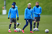 Ezgjian Alioski of Leeds United Under 23's and Ian Poueda of Leeds United Under 23's warming up before the U23 Professional Development League match between Barnsley and Leeds United at Oakwell, Barnsley, England on 9 March 2020.