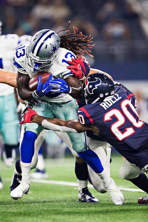 ARLINGTON, TX - SEPTEMBER 3:  Lucky Whitehead #13 of the Dallas Cowboys is tackled during a preseason game by Jumal Rolle #20 of the Houston Texans at AT&T Stadium on September 3, 2015 in Arlington, Texas.  (Photo by Wesley Hitt/Getty Images) *** Local Caption *** Lucky Whitehead; Jumal Rolle
