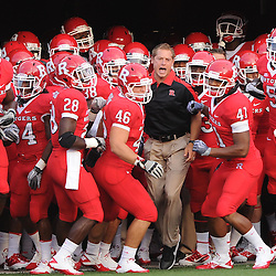 Rutgers wide receiver coach P.J. Fleck leads the Scarlet Knights onto the field for warmups before Rutgers defeats North Carolina Central 48-0 in NCAA college football action at High Point Solutions Stadium in Piscataway, N.J. on Sept 1, 2011.