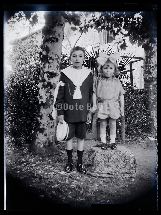 brother holy communion with little toddler sister France 1923