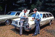 President Jimmy Carter and Vice President Walter Mondale get away from the crowd for a private talk while attending a church picnic at the Plains Baptist Church. - To license this image, click on the shopping cart below -