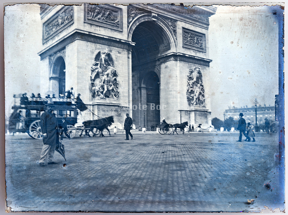 Paris street scene with Arc de Triomphe late 1800s or early 1900s