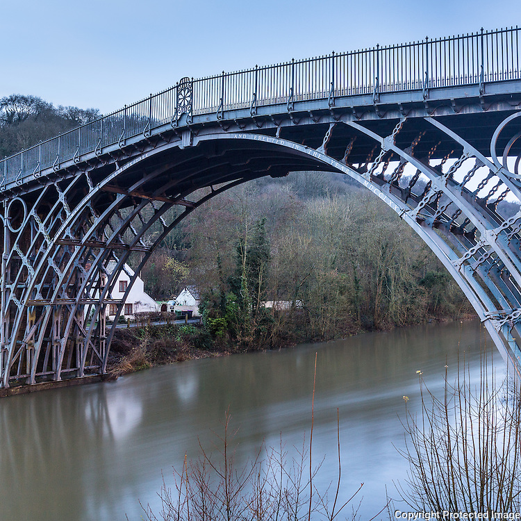 The Iron Bridge, Spanning the river Severn at Ironbridge Gorge near Coalbrookdale, UK. Opened in 1781, it was the first arch bridgein the world to be made of cast iron. The bridge is a UNESCO World Heritage Site site and a grade I listed building.