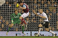 Picture by David Horn/Focus Images Ltd +44 7545 970036.30/01/2013.Kevin Nolan of West Ham United misses with a header during the Barclays Premier League match at Craven Cottage, London.