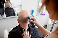 Man getting his head shaved in salon