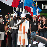 Sirwan Singh, center, of Surrey, British Columbia, the current holder of the Guinness World Record for longest beard, shows his beard in Bend, Oregon on Saturday, June 5, 2010 at the Beard Team USA National Beard and Mustache Championships.