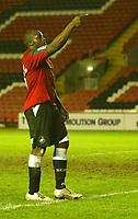 Photo: Aidan Ellis.<br /> Darlington v Swansea City. The FA Cup. 02/12/2006.<br /> swansea's Adebayo Akinfenwa celebrates his goal and teams third