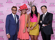 Actor and Longines Ambassador of Elegance Simon Baker, left, joins Jennifer Judkins, second left, US Longines Brand President, and Juan-Carlos Capelli, right, VP of International Marketing, Longines, to present Criselda Breene, second right, of Miami Beach, Fl. with her prize, a Longines timepiece from the Conquest Classic Collection, after she won the Longines Kentucky Oaks Fashion Contest on Kentucky Oaks Day, Friday, May 2, 2014, in Louisville, Ky.  Longines, the Swiss watch manufacturer known for its luxury timepieces, is the Official Watch and Timekeeper of the 140th annual Kentucky Derby. (Photo by Diane Bondareff/Invision for Longines/AP Images)