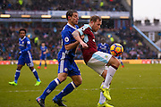 Burnley midfielder Scott Arfield (37) controls the ball under pressure from Chelsea defender Cesar Azpilicueta (28)  during the Premier League match between Burnley and Chelsea at Turf Moor, Burnley, England on 12 February 2017. Photo by Simon Davies.