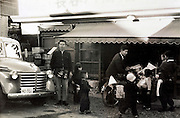 owner in front of the family grocery and liquor store Japan Yokosuka 1950s