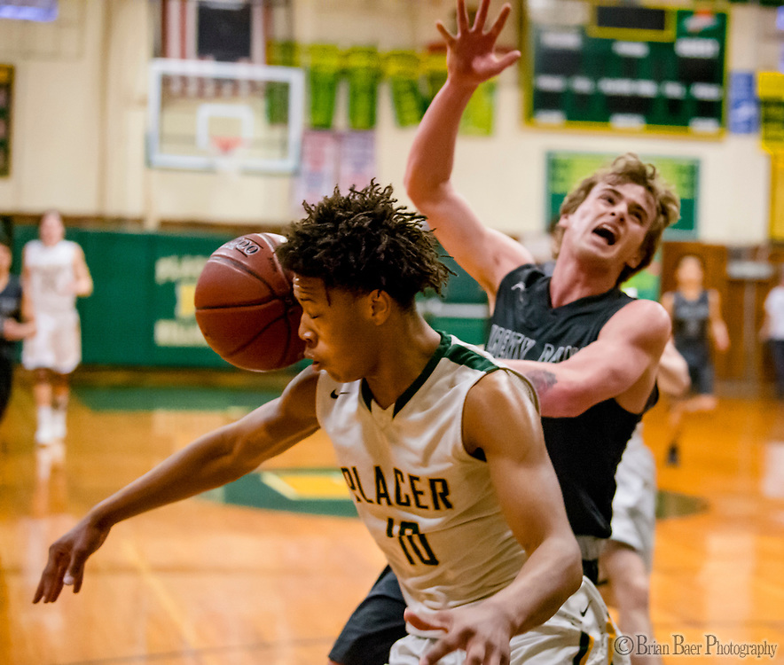 Placer Hillman Kai Huntsberry (10), steels the ball from Liberty Ranch Hawks Chandler Garcia (0), during the first quarter as the Placer Hillman host the Liberty Ranch Hawks Varsity basketball team in the DIV NorCal boys quarterfinal, Saturday Mar 10, 2018.  <br /> photo by Brian Baer