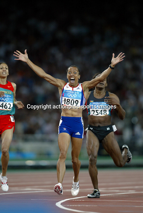 23 August 2004: British runner KELLY HOLMES (GBR) shows her surprise at winning the Women's 800m Final at The 2004 Olympic Games in Athens, Greece. <br />Photo: Glyn Kirk/Action Plus/Photosport<br /> <br /> <br /> 040823 olympics woman athlete joy celebrate celebration celebrations celebrates winner winners