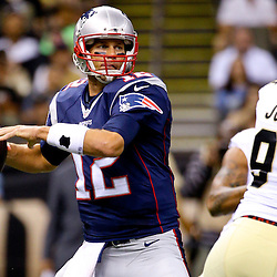 Aug 22, 2015; New Orleans, LA, USA; New England Patriots quarterback Tom Brady (12) throws against the New Orleans Saints during the first quarter of a preseason game at the Mercedes-Benz Superdome. Mandatory Credit: Derick E. Hingle-USA TODAY Sports