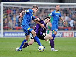 Bristol Rovers' John-Joe OToole challenges for the ball with  AFC Wimbledon's Harry Pell - Photo mandatory by-line: Dougie Allward/JMP - Mobile: 07966 386802 05/04/2014 - SPORT - FOOTBALL - Kingston upon Thames - Kingsmeadow - AFC Wimbledon v Bristol Rovers - Sky Bet League Two