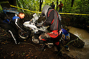 Bill Dragoo from Oklahoma (gray helmet) guides bike while Kevin ? from Paso Robles California and Briene Thompson from San Diego (blue gear) push and strain to lift R1200GS out of water-filled creek.  Rain from Hurricane ? had drenched the Spartanburg area two days before the competion.
