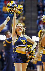 Dec 30, 2018; Morgantown, WV, USA; A West Virginia Mountaineers cheerleader performs during the second half against the Lehigh Mountain Hawks at WVU Coliseum. Mandatory Credit: Ben Queen-USA TODAY Sports