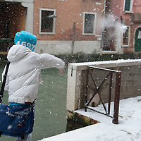 VENICE, ITALY - DECEMBER 17:  Childrens play snowball fight near one of the canals on December 17, 2010 in Venice, Italy. Snow has fallen across much of Europe today and is expected to continue over the weekend, causing traffic chaos and disrupting Christmas deliveries.