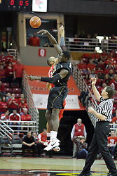 17 February 2013:  Jackie Carmichael and Ehimen Orukpe tip off during an NCAA Missouri Valley Conference mens basketball game where the Shockers of Wichita State played the Illinois State Redbirds  in Redbird Arena, Normal IL