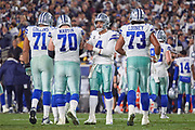Jan 13, 2019; Los Angeles, CA, USA; Dallas Cowboys quarterback Dak Prescott (4) talks to Dallas Cowboys offensive guard Zack Martin (70) during an NFC Divisional playoff football game against the Dallas Cowboys at Los Angeles Memorial Coliseum. The Rams defeated the Cowboys 30-22. (Robin Alam/Image of Sport)