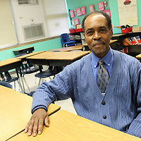 Retired Aberdeen Elementary School third-grade teacher Rodger Scott sits in his former classroom. Scott's new affiliation with the school district begins Jan. 17 during his first meeting as an Aberdeen School Board member.